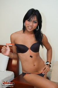 asian shemale slut poses in a lingerie